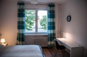 Łóżko lub łóżka w pokoju w obiekcie Apartament Glinki