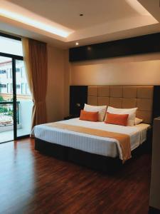 Postelja oz. postelje v sobi nastanitve Hotel Oazis