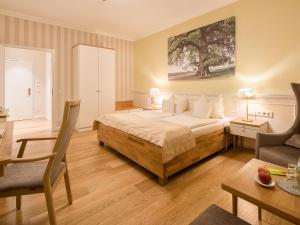 A bed or beds in a room at Hotel Landhaus Ammann