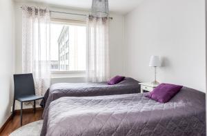 Vuode tai vuoteita majoituspaikassa Apartment Pohjantähti