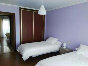 A bed or beds in a room at Arzua HOME