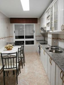 A kitchen or kitchenette at Arzua HOME