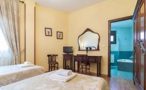 Cama o camas de una habitación en Hotel Casa Reboiro
