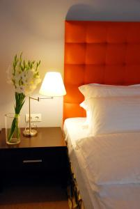 A bed or beds in a room at Bontiak Hotel