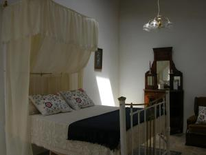 A bed or beds in a room at Avalon Traditional Village Houses