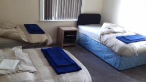 A bed or beds in a room at The Victoria