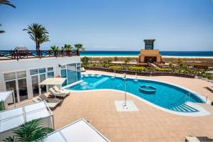 The swimming pool at or near Occidental Jandia Playa