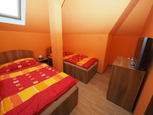 A bed or beds in a room at Penzion U Krejzů