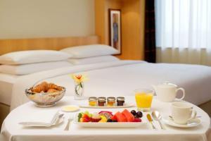 A bed or beds in a room at Hyatt Regency Dubai - Corniche