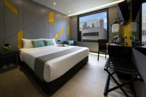 A bed or beds in a room at Hotel Mi