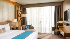 A bed or beds in a room at InterContinental Nha Trang, an IHG Hotel