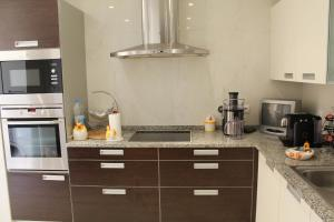 A kitchen or kitchenette at Apartment with breath-taking view