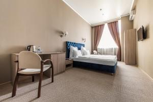 Кровать или кровати в номере Фортис Отель Москва Дубровка