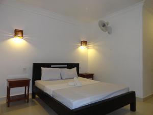 Ein Bett oder Betten in einem Zimmer der Unterkunft Green Park Village Guesthouse