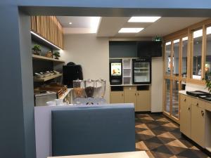 A kitchen or kitchenette at Hôtel Icare