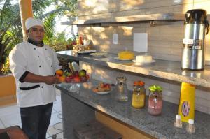 A kitchen or kitchenette at Val Paraiso Pousada