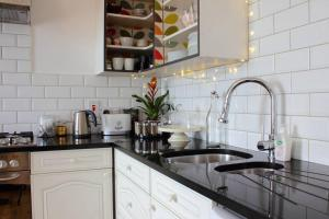 A kitchen or kitchenette at Beach Fronted Apartments Warrenpoint, Carlingford Bay