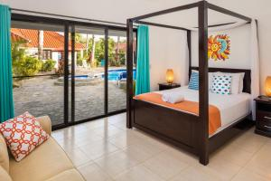 A bed or beds in a room at Garden By The Sea