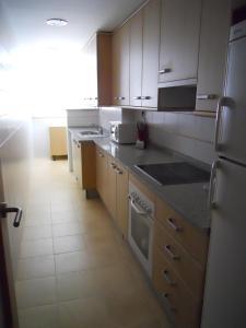 Una cocina o zona de cocina en Apartamentos Punta Cormoran