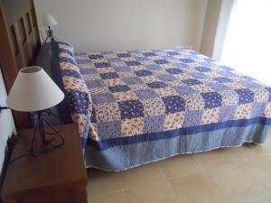 Cama o camas de una habitación en Apartamentos Punta Cormoran