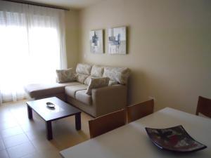 Zona de estar de Apartamentos Punta Cormoran