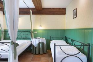 Cama o camas de una habitación en Quinz - Locanda Al Lago