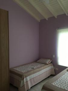 A bed or beds in a room at Casa Pauba