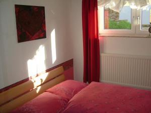 Een bed of bedden in een kamer bij Querbach