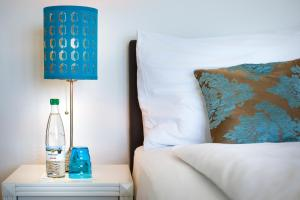 Ein Bett oder Betten in einem Zimmer der Unterkunft Hotel Sonnenberg