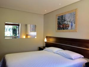 A bed or beds in a room at Residencial Jardim dos Pinheiros 279