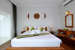 A bed or beds in a room at Princess River Kwai Hotel
