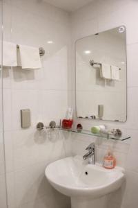 A bathroom at BX Hotel Apartment