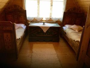 Łóżko lub łóżka w pokoju w obiekcie Sweet Home Sweet