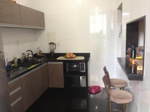 A kitchen or kitchenette at Minussi 2 quartos
