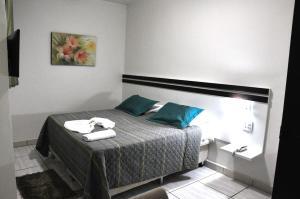 Кровать или кровати в номере Hotel Lago Conchal