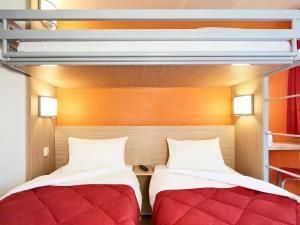 Un ou plusieurs lits dans un hébergement de l'établissement Premiere Classe Lyon Ouest - Tassin