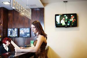 TV in/ali zabaviščno središče v nastanitvi Hotel Marinšek