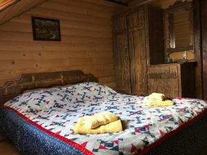A bed or beds in a room at Guest House Zator