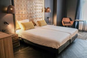 Een bed of bedden in een kamer bij Hotel Brouwerij Het Anker