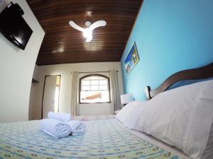 A bed or beds in a room at Viva la Vida