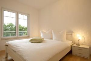 Ein Bett oder Betten in einem Zimmer der Unterkunft Haus Ostseeblick