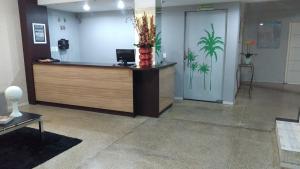 The lobby or reception area at Hotel e Churrascaria Coqueiro Verde