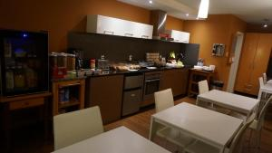 A kitchen or kitchenette at NUVO Hotel Suites for Residence