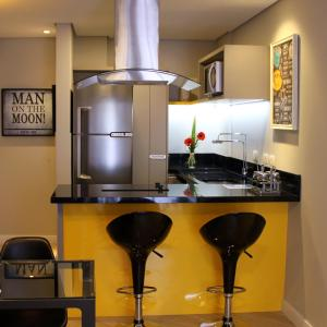 A kitchen or kitchenette at Apto Curitiba Cond. Clube Sky