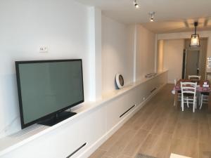 Télévision ou salle de divertissement dans l'établissement apartment Seaside