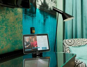 Een TV en/of entertainmentcenter bij Hotel Capricorno