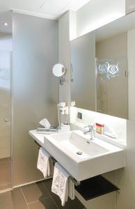 Een badkamer bij Hotel Capricorno