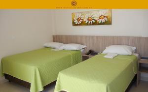 Cama ou camas em um quarto em Hotel Castro