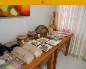 Opções de café da manhã disponíveis para hóspedes em Hotel Castro
