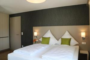 A bed or beds in a room at BA Hotel